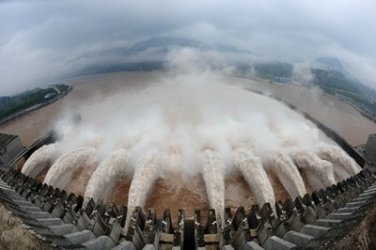 In this photo released by China's Xinhua news agency, flood water is released from the Three Gorges Dam's floodgates in Yichang, in central China's Hubei province, Tuesday, July 20, 2010. Rescuers were searching Tuesday for 30 people buried in landslides as flood waters from days of heavy rain surged past the Three Gorges Dam, the world's largest. (AP Photo/Xinhua, Cheng Min) ** NO SALES **
